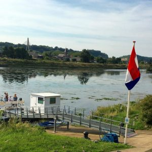 small ferry for hikers and bikers only over the river Meuse at Eijsden